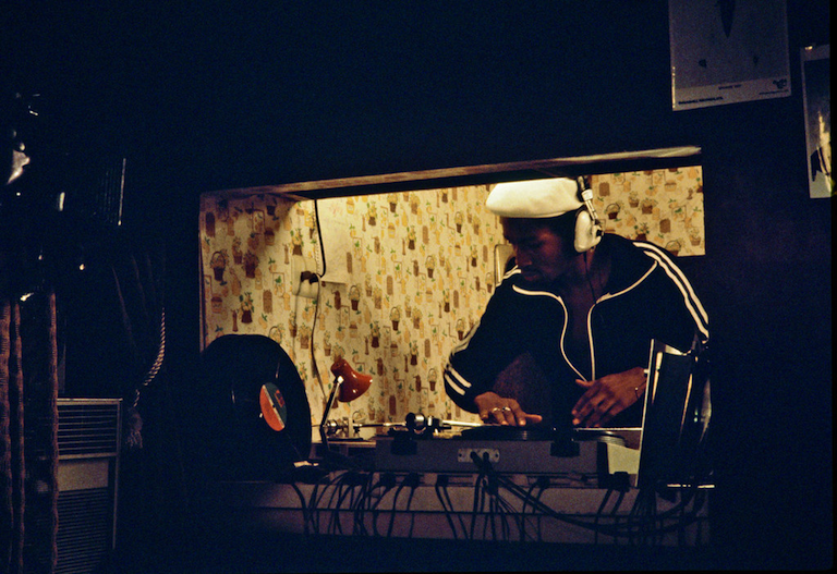 "Grandmaster Flash in his kitchen, filming of ""Wild Style"" (c. 1982)"