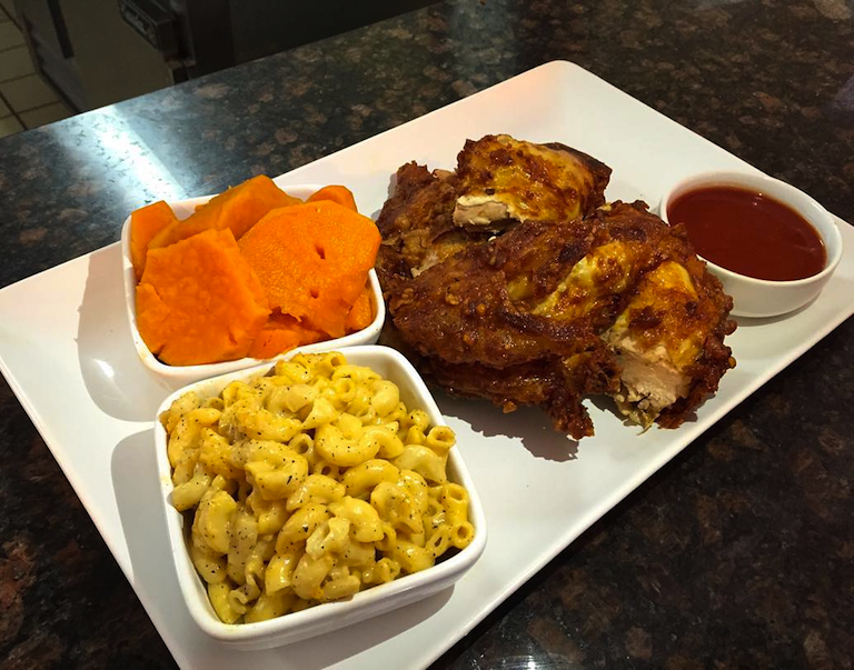 Chicken Dinner with a side of yams and mac & cheese with homemade BBQ sauce