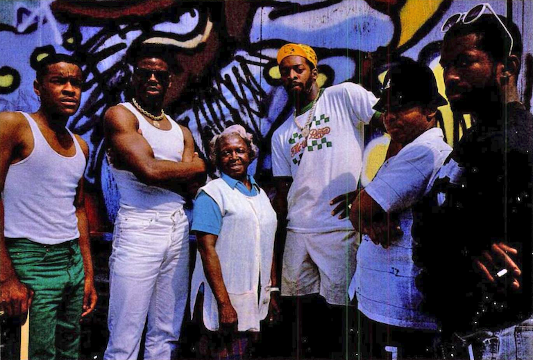 Schooly-D (second from left) and DJ Code Money (far left)